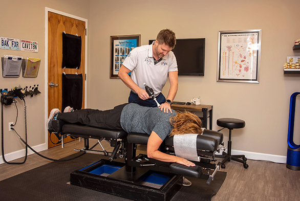 Chiropractor Swansea IL Dr. Jonathan Currier Adjusting Patient